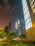 View of Petronas Twin Tower Kuala Lumpur, Malaysia at Night. View of Petronas Twin Tower in Kuala Lumpur, Malaysia at night, surrounded with commercial building stock photos