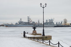 View from Petrovsky quay on military ships of the Baltic Navy gray day. Kronstadt Stock Image