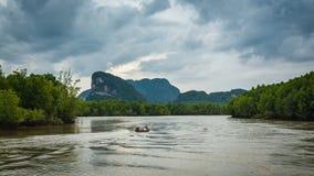 View of phang nga bay, Thailand. View of phang nga bay with cloudy sky during rainy season, Thailand Royalty Free Stock Photo