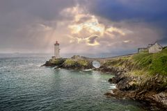 View of the Phare du Petit Minou in Plouzane, Brittany, France. The Phare du Petit Minou is a lighthouse in the roadstead of Brest, standing in front of the Fort stock images