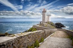 View of the Phare du Petit Minou in Plouzane, Brittany, France. The Phare du Petit Minou is a lighthouse in the roadstead of Brest, standing in front of the Fort stock image