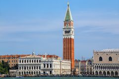 View of Piazza San Marco with Campanile, Palazzo Ducale and Biblioteca in Venice, Italy. These buildings are the most recognizable symbols of the city stock photos