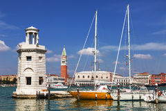 View of the Piazza San Marco, the lighthouse at the island of San Giorgio Maggiore and yachts at berth. Venice Royalty Free Stock Photography