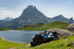View of the Pic du Midi d`Ossau in the French Pyrenees. View of mountain the Pic du Midi d`Ossau in the French Pyrenees with backpacks Royalty Free Stock Photos