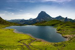 A view of the Pic du Midi d`Ossau with lake in the French Pyrenees. View of the Pic du Midi d`Ossau with lake in the French Pyrenees Stock Image