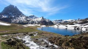 View of Pic du Midi Ossau in the french Pyrenees with a waterfall