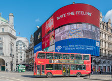 View of Piccadilly Circus in London with double decker bus Stock Photo