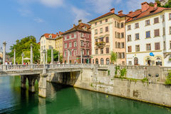 View of the picturesque embankment of the Ljubljanica river with beautiful old houses. royalty free stock photos
