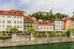 View of the picturesque embankment of the Ljubljanica river and Ljubljana castle. stock image