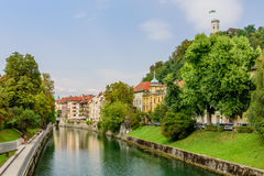 A view of the picturesque embankment of the Ljubljanica river and Ljubljana castle. stock image