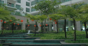 View of picturesque garden with fountain against modern building. Kuala Lumpur, Malaysia stock video footage