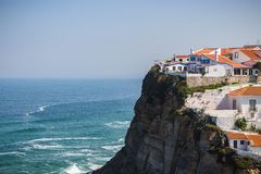 View of the Picturesque village Azenhas do Mar. On the edge of a cliff with a beach below. Landmark near Sintra, Lisbon, Portugal royalty free stock photo