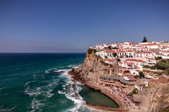 View of the Picturesque village Azenhas do Mar. On the edge of a cliff with a beach below. Landmark near Sintra, Lisbon, Portugal stock photos