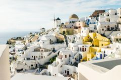 Oia with traditional windmills in Santorini, Greece stock images