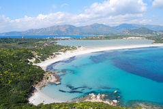 View of a piece of colorful nature in Villasimius (Sardinia) wit. H lake, sea mountain and cloudy sky. Lagoon of Porto Giunco for tourism royalty free stock photos