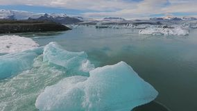View of pieces of blue icebergs near the coast of Iceland. Andreev. View of pieces of blue icebergs near the coast of Iceland. The current flows around the blue stock video
