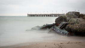 View on a pier from a beach Royalty Free Stock Images