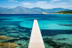 View of a pier in beautiful turquoise lagoon on Corsica island Stock Photography