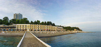 View from the pier on the city beach on a summer evening. Royalty Free Stock Images