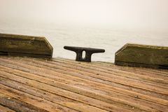 View of the pier. At Halifax, NS, CA. Near to the seashore. Winter season. Foggy day. Pathway. No person royalty free stock photography