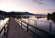 View on pier of harbour and marina at Brentwood Bay, BC at sunse Royalty Free Stock Photography
