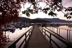 View on pier of harbour and marina at Brentwood Bay, BC at sunse Royalty Free Stock Images