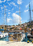 View from pier on the island of Symi in the house and sailing yachts Royalty Free Stock Photography