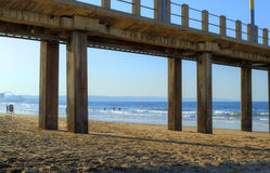 View Through A Pier in Late Afternoon on Golden Mile Beach, Durban, South Africa Royalty Free Stock Images