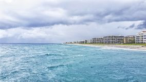 Juno Beach Florida. View from the pier off Juno beach in South Florida. On this story day the ocean with its blue waters gave off an amazing view for all to stock photo