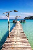 Old wooden pier in the sea Stock Photo