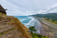 View of Piha beach in New Zealand. From the slopes of Lion`s rock stock image