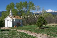 A View of Pikes Peak from a Chapel. This is a view of Pikes Peak from Colorado Springs. There is a small chapel and a footpath in the foreground. Pikes Peak is Royalty Free Stock Photos