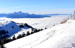 View of Pilatus above the sea of clouds from the Rigi Kulm in wi. Nter, Lucerne, Switzerland royalty free stock images