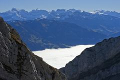 View from the Pilatus massif across the autumnal sea of fog to the Titlis peak. Alpnachstad, Schweiz Royalty Free Stock Images