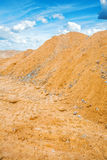 View on the pile of construction sand and sky Royalty Free Stock Image