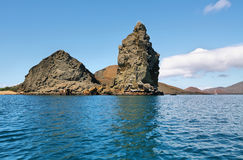 View of pinnacle rock from the sea Stock Photo