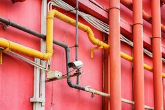 View of pipe system outside a red building royalty free stock photos