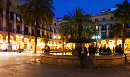 View of Placa Reial with fountain in evening. Barcelona Royalty Free Stock Image