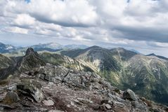 View from Placlive mountain peak on Rohace mountain group in Zapadne Tatry mountains in Slovakia. With nearest sharp Ostry Rohac peak and many other peaks of royalty free stock image