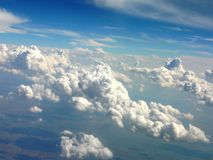 View from a plane -1. View of clouds and earth below from a plane Royalty Free Stock Image