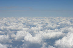View From the Plane. Puffy clouds - view from the plane's window Royalty Free Stock Images