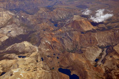 View from the plane. Flight over the Rocky Mountains Stock Images