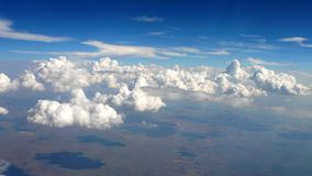View from a plane -2. View of clouds and earth below from a plane Royalty Free Stock Images