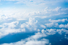 The View from the plane above the cloud and sky Royalty Free Stock Photography