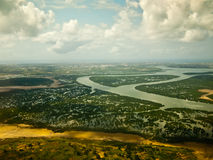 View from the plane on an African river. On background sky Stock Images