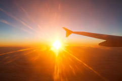 View from the plane on a beautiful orange sunset Stock Image