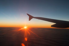 View from the plane on a beautiful orange sunset Stock Photo
