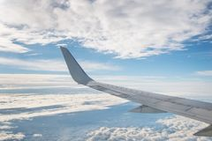 The view from the plane. Blue sky with clouds on a Sunny day. stock photos