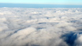 View from plane on the clouds stock footage