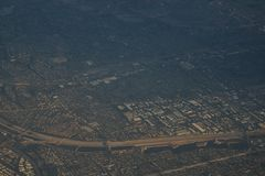View from plane during flight over Los Angeles in sunset. Travel photo Royalty Free Stock Photo